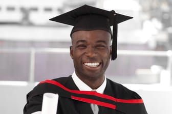 Man smilling at university graduation celebration